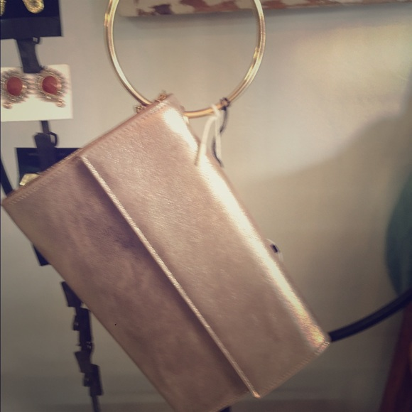 Handbags - Rose gold metallic clutch